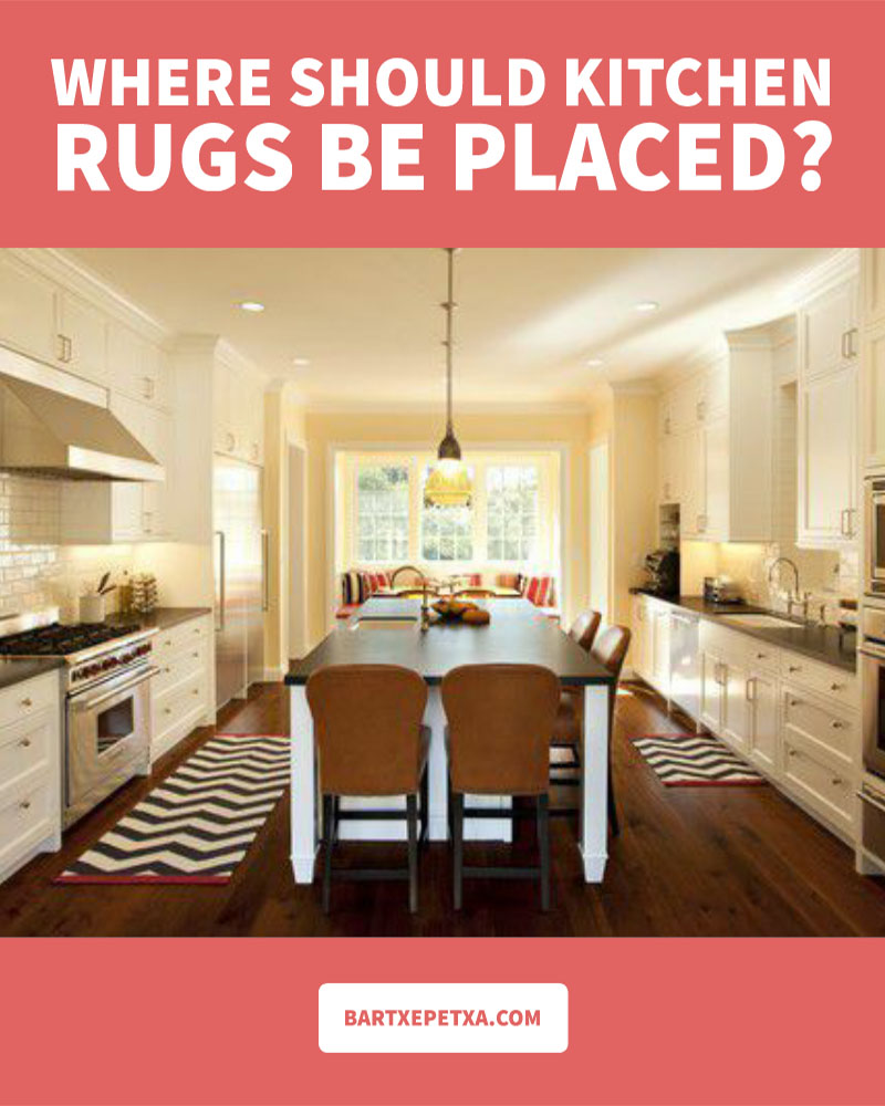 Where should kitchen rugs be placed?